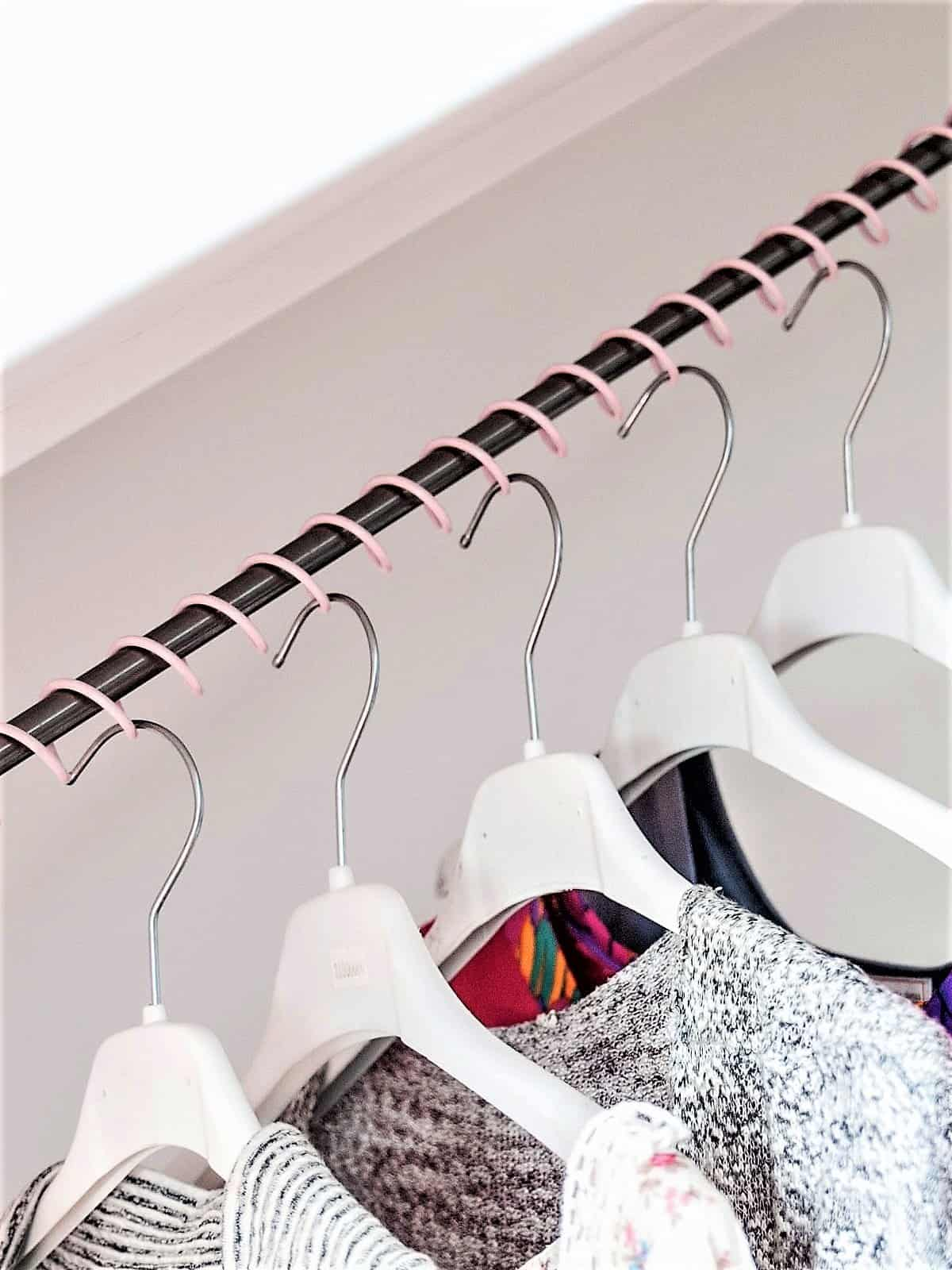 Zebedee Any Angle Hanging Rail - Millennial Pink - Shown with coat hangers