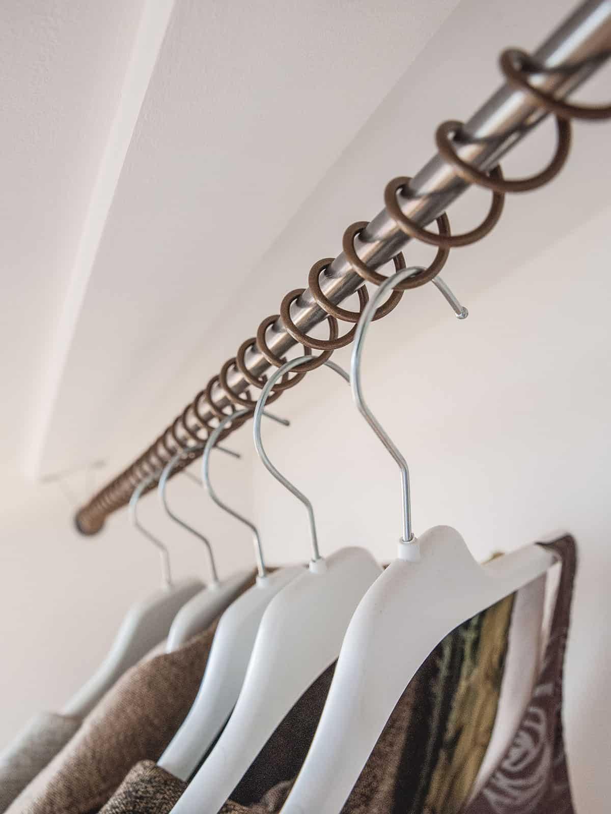 Zebedee Any Angle Hanging Rail - Bronze with coat hangers