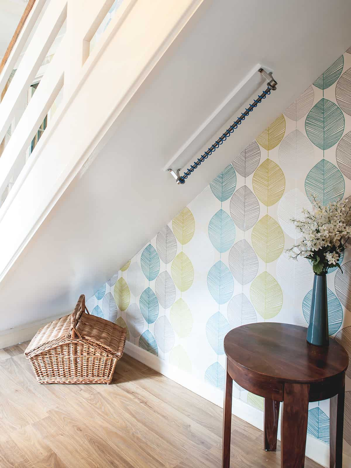 Zebedee Any Angle Hanging Rail - Primary Blue - Shown on angled / sloped ceiling