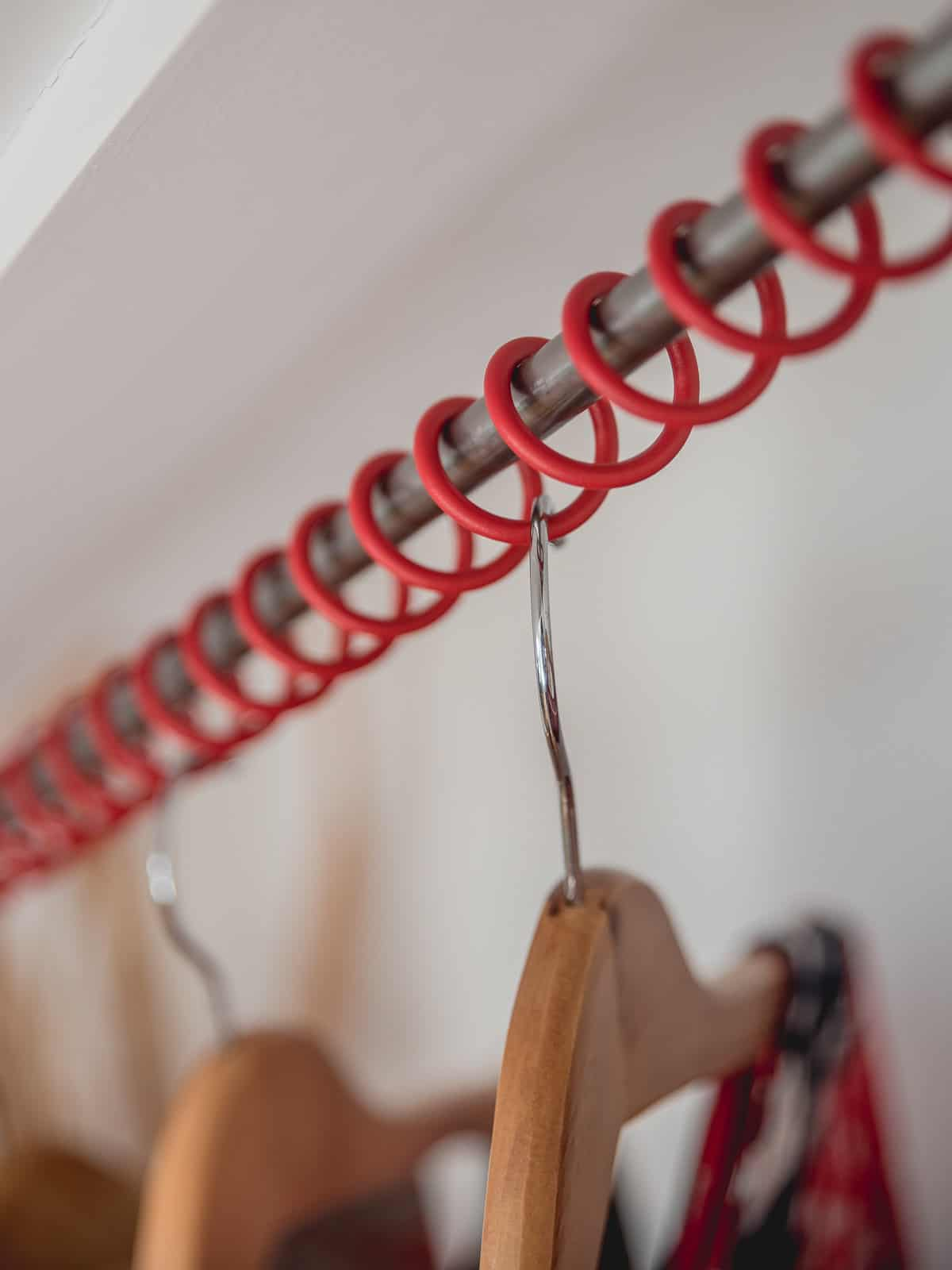 Zebedee Any Angle Hanging Rail - Textured Red with Coat Hangers